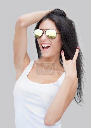 Woman  showing rocker gesture