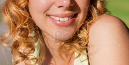 Photo for Close up face of unrecognizable blond woman with curly hair in yellow singlet in green nature. Sunny summer - Royalty Free Image