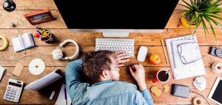 Businessman sleeping on desk