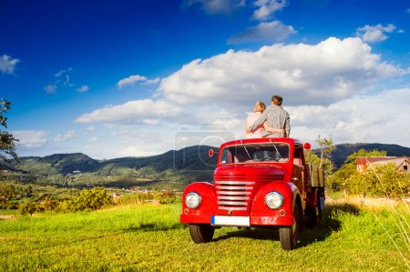 Senior couple in pickup truck