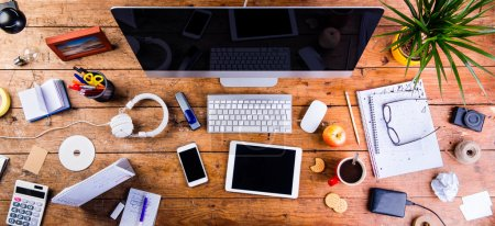 Photo for Desk with various gadgets and office supplies. Computer, smart phone, tablet and stationery around the workplace. Flat lay. - Royalty Free Image