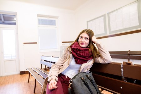 Beautiful young woman traveling, sitting in bus wa...