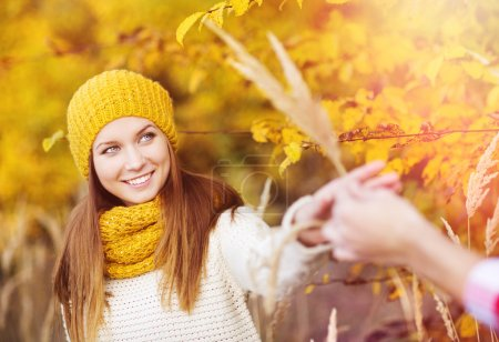 Photo for Portrait of beautiful girl with scarf and hat in yellow autumn nature - Royalty Free Image