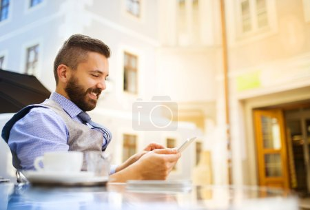 Businessman drinking coffee during lunch time
