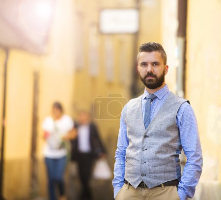 Photo for Handsome hipster modern businessman with beard walking in town - Royalty Free Image