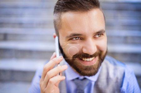 Businessman talking on smart phone