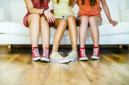 Young girls sitting on sofa