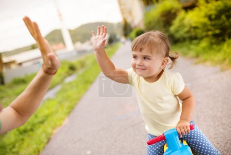 Girl does high five with her dad