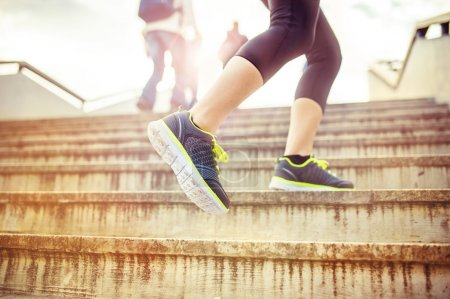 Runner running up the stairs
