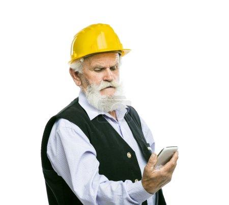 Senior manual worker calling on phone