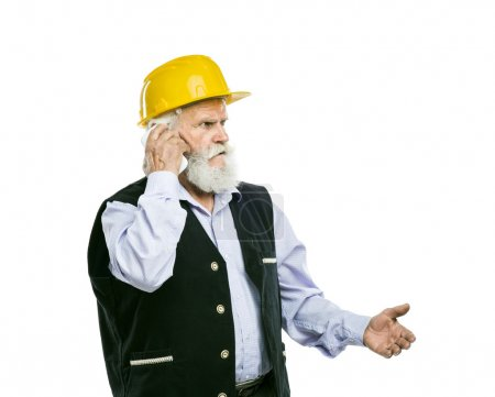 Senior manual worker calling on phone