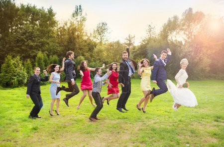 Bridesmaids and groomsmen jumping