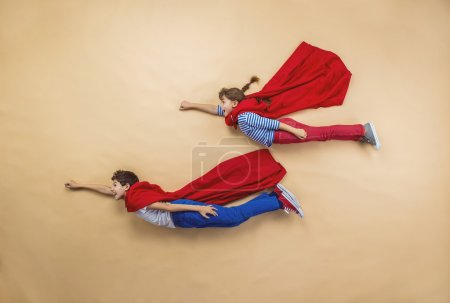 Children are playing as superheroes