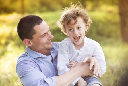 Photo for Little boy and dad enjoying their time together outside in nature - Royalty Free Image