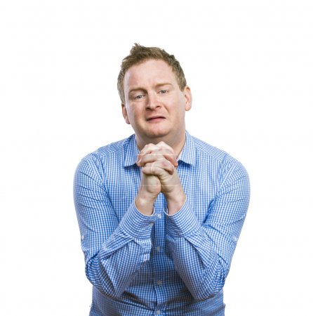 Man praying with clenched hands