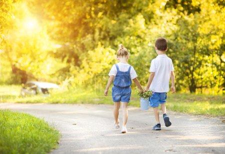 Little boy and girl taking a walk