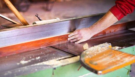 Hands of Carpenter working in his workshop