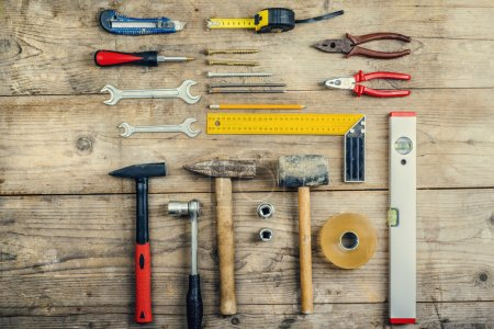 Photo for Desk of a carpenter with different tools. Studio shot on a wooden background. - Royalty Free Image