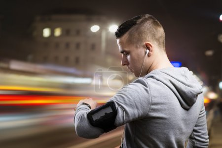 Young sportsman jogging in the  city