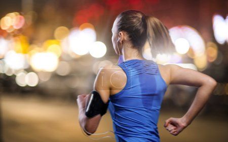 Woman jogging at night