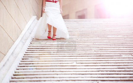 Bride running down the stairs