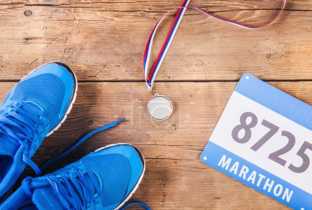 Running shoes, medal and race number