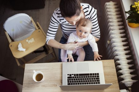 Mother with her daugher working from home