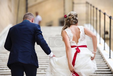 Young wedding couple on the stairs