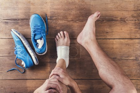 Injured runner with blue shoes