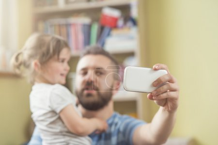 Photo for Young father with his cute little daughter taking selfie - Royalty Free Image