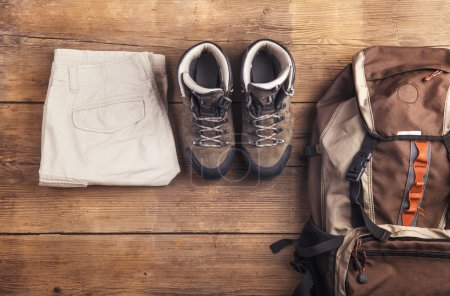 Photo for Equipment for hiking on a wooden floor background - Royalty Free Image