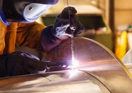 Man welding in a factory