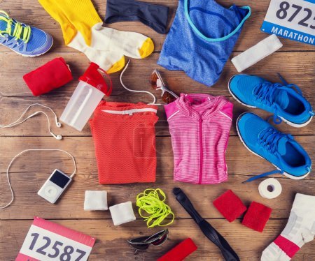 Photo for Various running stuff laid on a wooden floor background - Royalty Free Image