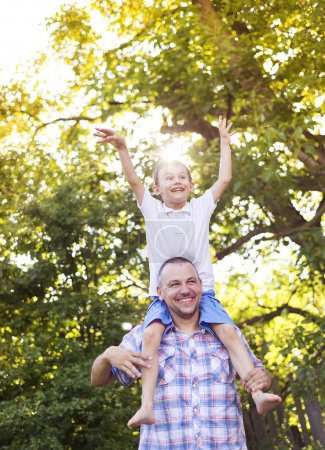 Photo for Happy father with his son spending time together outside in green nature. - Royalty Free Image