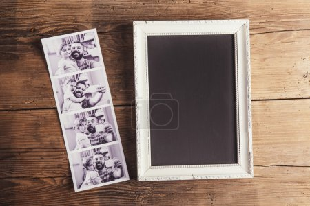 Photo for Picture frame, instant photos on wooden background. - Royalty Free Image