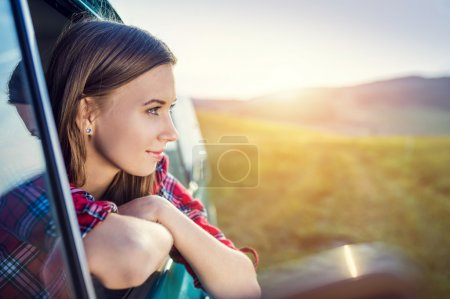 Photo for Teenage girl travelling driving vintage van on a summer day - Royalty Free Image