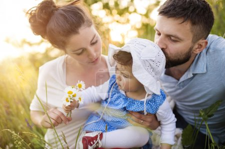 Photo for Happy young family having fun outside in spring nature - Royalty Free Image