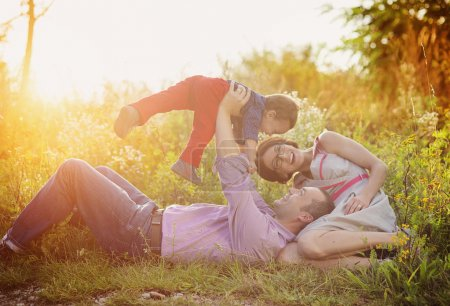 Photo for Happy young family having fun outside in summer nature - Royalty Free Image