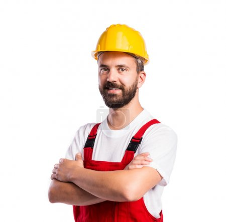 Photo for Young handsome worker in red overalls. Studio shot on white background - Royalty Free Image