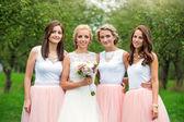 Bride with bridesmaids at wedding