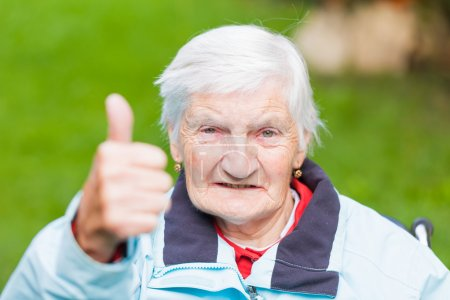 Photo for Portrait of elderly woman shows thumbs up - Royalty Free Image