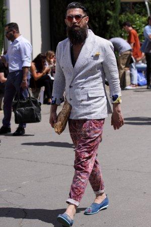 Man on Pitti uomo 87 fashion fair in Florence, Italy