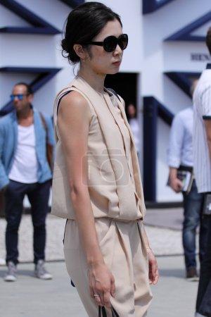 Woman on Pitti uomo 87 fashion fair in Florence, Italy