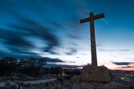 stone cross with sky background dusk cloudy