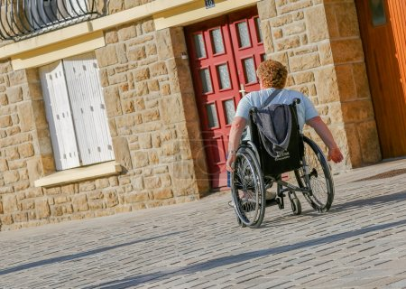 Disabled man passing by