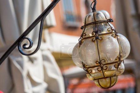 Beautiful venetian ornate lampposts with murano gl...
