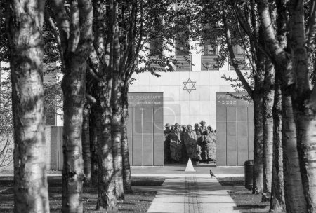 PUTEAUX, FRANCE - MAY 10, 2015:  memorial of the martyrs of the Holocaust in Puteaux on which it is writing in French and Hebrew language (to the martyrs of the Holocaust, peace to Their Souls)