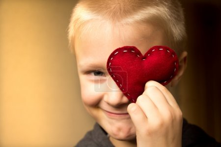 Photo for Happy cute child (kid, boy) with hand made red heart. Valentines day and family love concept. Horizontal close up portrait. - Royalty Free Image
