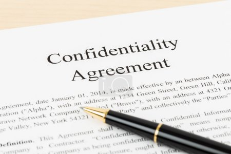 Confidentiality agreement document with pen close-...