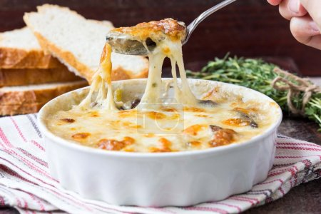 Mushrooms gratin with cream, cheese, French dish julienne